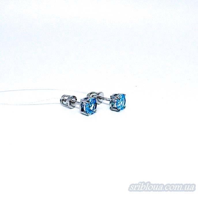 Серебряные серьги-гвоздики со вставками голубого топаза (арт. 20020/9)